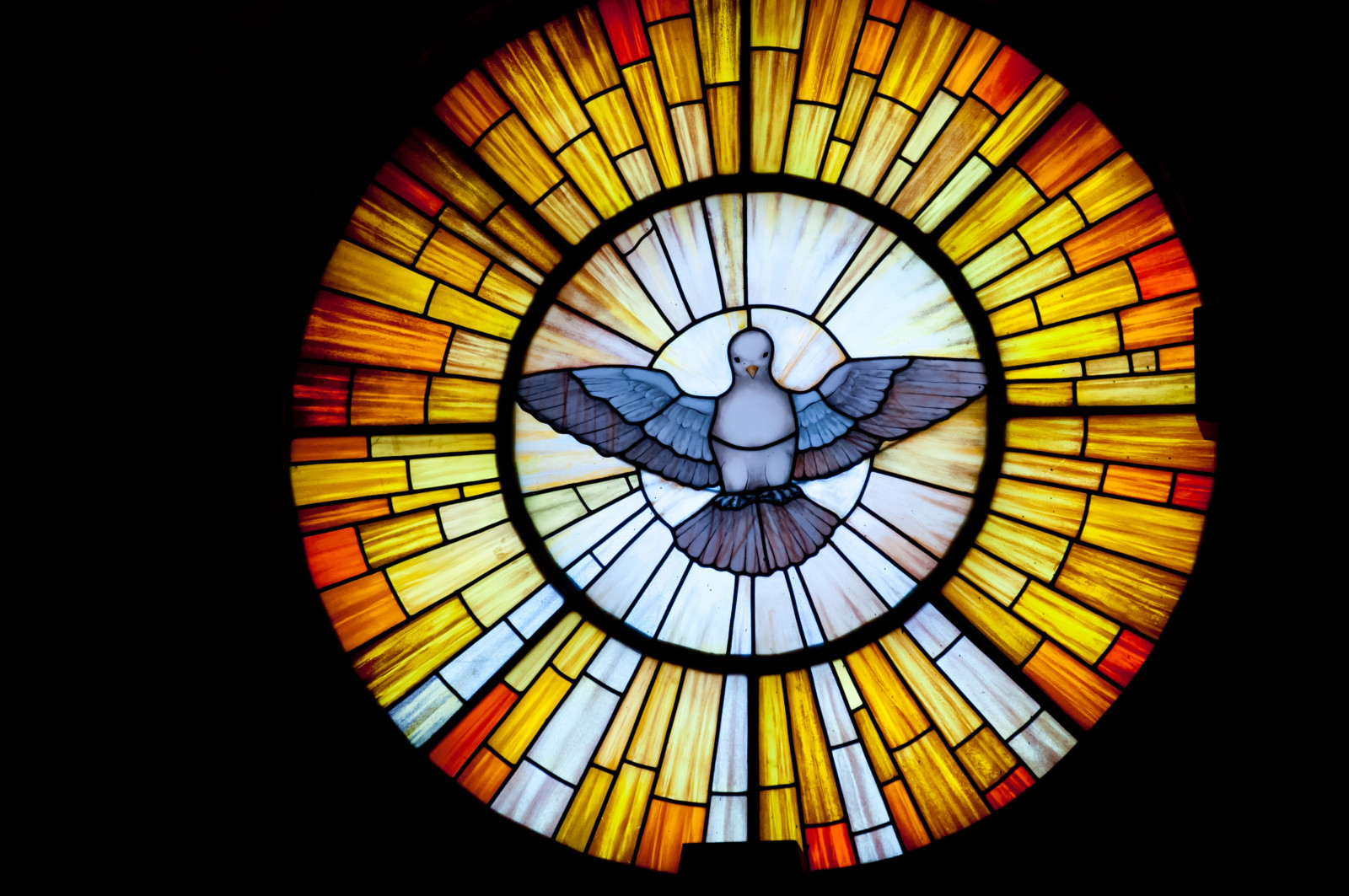 Stained glass picture of Outpouring of the Holy Spirit.